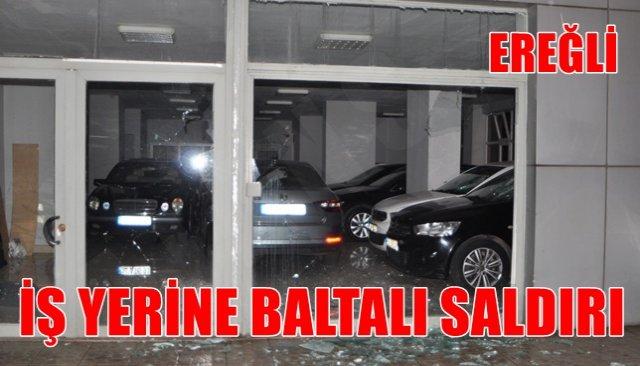 Dükkanın ve araçların camları kırıldı